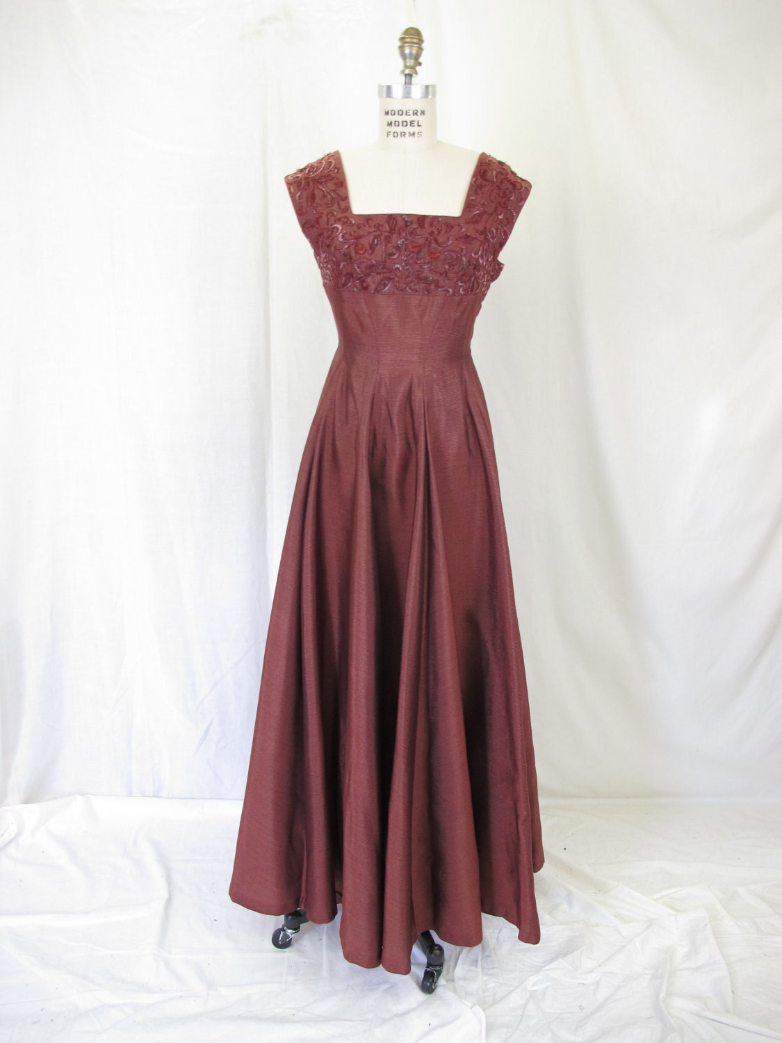 1940s burgundy beaded sleeveless evening gown by tovasvintage