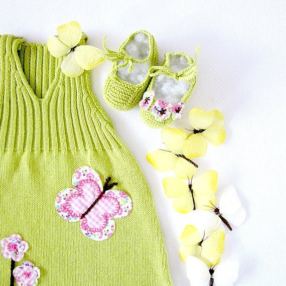 A knitted baby dress with flowers and butterflies in green-lime. 100% cotton. Newborn.