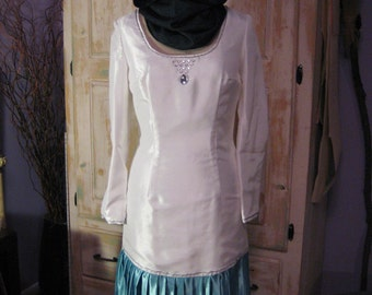 White shantung dress with teal pleated flounce
