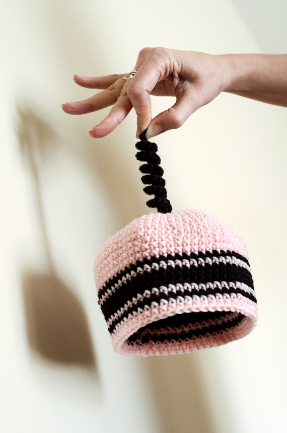 Pink and brown striped crochet baby beanie with curly topper
