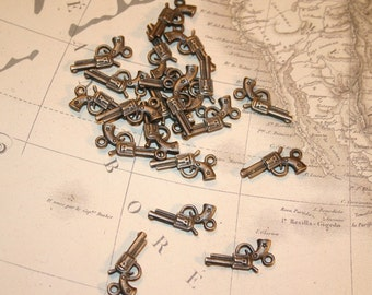 Large Quantities ON SALE NOW - antiqued brass pistol charms set of 60