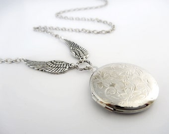 Silver Locket with stunning antiqued silver wings