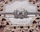 Rhinestone Center Platinum Look Slender Vintage Brooch