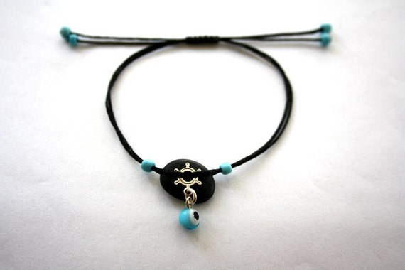 "bracelet with beach pebble and sterling silver steering  wheel and an"" evil eye"" glassbead...adjustable"