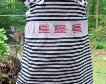 Smocked. Patriotic. Fourth of July. Red, White, and Blue Criss Cross Dress with Ruffled Bloomers.