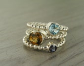 Carmine Rings, cognac quartz, sky blue topaz and iolite stacking rings