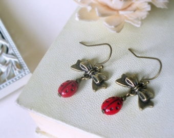 Coccinella - ladybug earrings - Antiqued brass tiny bow Czech glass garnet  red  Vintage style woodland jewelry preppy