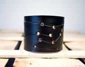 Black leather cuff Sagittarius constellation