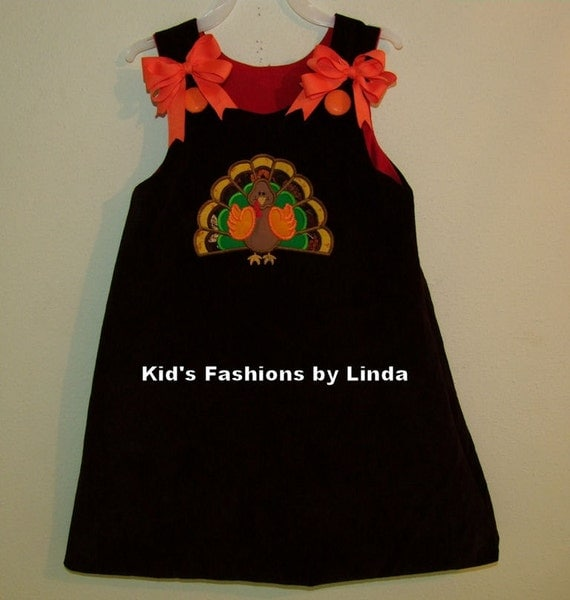 Reversible brown cord red cord turkey present aline dress with bows