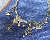 Neo-Victorian / Steampunk gold-toned necklace with bird pendant and garnets