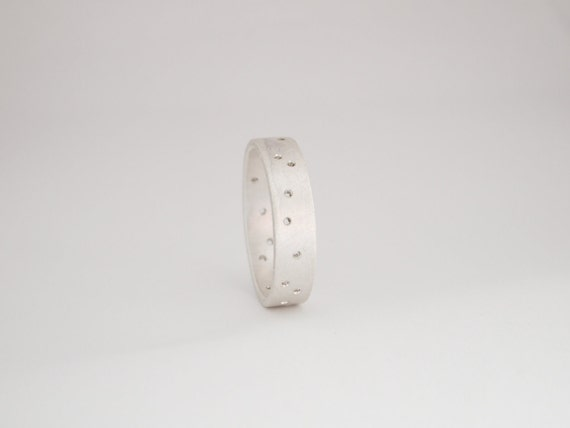 Starlight Surf Wedding Ring Band. Sterling silver sprinkled with a constellation of pin holes.Spring Fashion