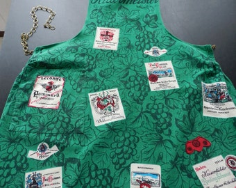 Vintage printed German Wine Cellar Master Apron in green, white, red and black with unique metal chain tie