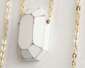 Diamond. white. geometric necklace. geometric jewelry. geometric pendant. faceted, diamond jewelry. wooden gemstone on golden chain.