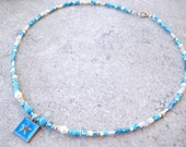 BLUE STARRY SKY- Blue and Silver Girl's Beaded Necklace- Swarovski crystals, soft white pearls, Cat's Eye beads, and clay and glass beads