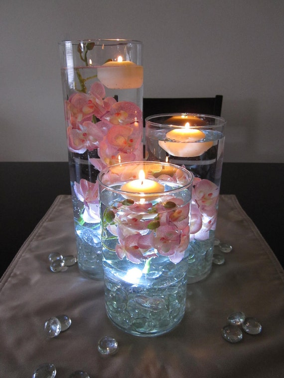 Items similar to pink orchid floating candle wedding