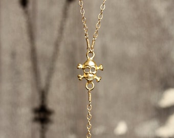 Rock Steady. Gold Rosary Necklace. Gold Skull Charm Blue Topaz