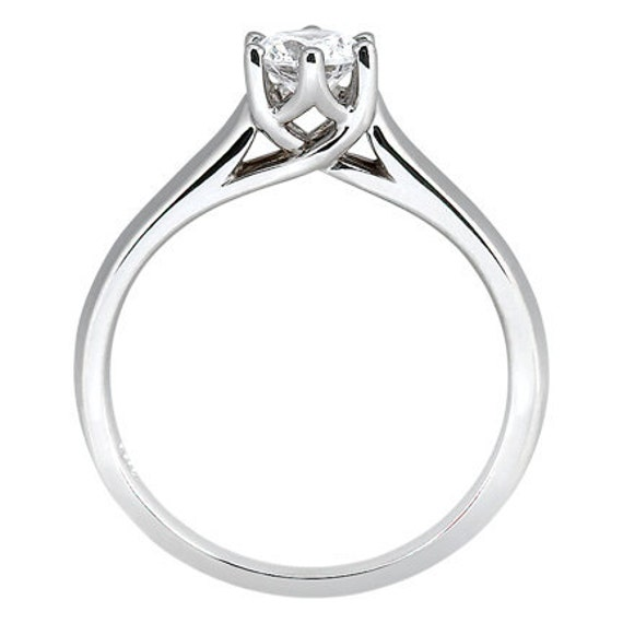 Beautiful 14k  White Gold Solitaire Engagement Ring with .75ct. Finest Quality Cubic Zirconia