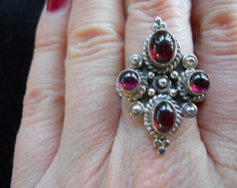 Old garnet cabachon ring