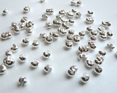 50 Crimp bead covers silver plated 4mm DB03073