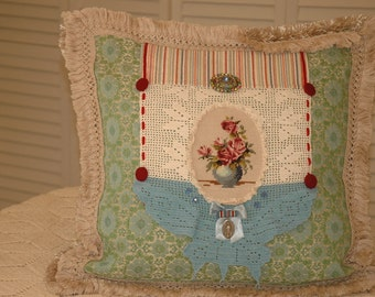 Butterfly Pillow with vintage buttons and jewelry.