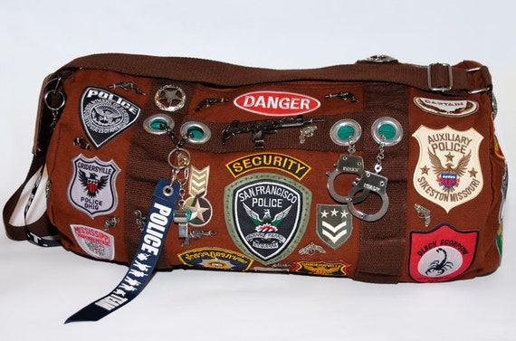 Police Themed Duffel Bag by Spirale Rouge