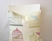 18 inch throw pillow cover, Birds and birdcages, cream with multicolors. Whimsical, modern print. For indoor use.