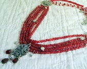 Red statement necklace, bibstyle