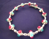 Red, Aqua, and Ivory on Silver Bracelet featuring unique handmade lampwork glass beads