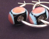 unique handmade lampwork glass earrings featuring sky blue and rose on black beads