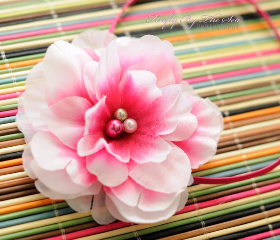 One of a kind flower headband in white and hot pink tones with multiple pearl center on a hot pink skinny elastic great photo prop