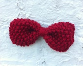 Bright red hand-knit bow