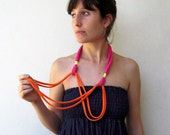The birdie necklace - handmade in orange and fuchsia jersey fabrics with neon yellow strands