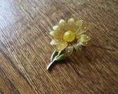 Vintage flower brooch with gold stem and back.