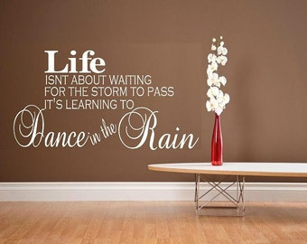 vinyl wall decal quote Life isnt about waiting for the storm to pass its Learning to dance in the rain