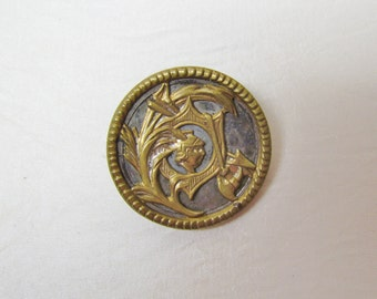 Antique metal button, Victorian brass and tin warrior's head button