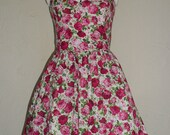 50's rockabilly summer dress with halter straps. Pink and white floral.