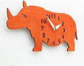 "The ""Rotund Rhino in Orange"" Kid's wall mounted clock from LeLuni"