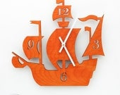 """The """"Dread Pirate Roberts"""" in Orange, a designer wall mounted clock from LeLuni"""