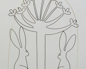 Hares in love, under an allium flower. Wire doodle wall hanging or mobile.
