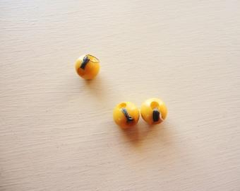 set of three yellow/gold round vintage bakelite buttons