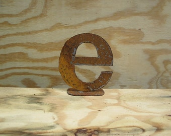 "Lowercase metal letter ""e"" on stand"