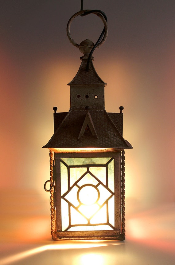 Vintage lantern for outdoor use . colorful warm light . electrified . shabby . patina . rusty charm
