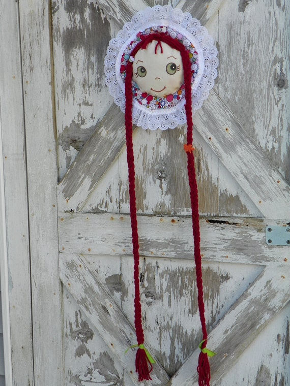 Barrette Holder with Green Eyes long Dark Red braids and Cupcake charm accent Bonnet is Multi color circles trimmed with lace