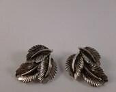 Silver leaf clip earrings. (C73)