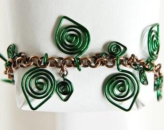 """Brown and Green Charm Bracelet Celtic Spirals Green Leaf Charms 7.5"""" Copper Bracelet"""