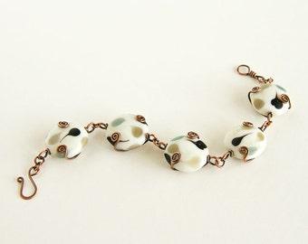 Copper Bracelet Black and White Lampwork Beads Large Beads Chunky Bracelet Antiqued Copper Celtic Spirals