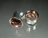 Gauged ear ring plugs hand forged from fine silver and copper
