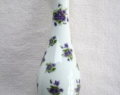 Lefton bud vase with violet chintz and gold trim on white porcelain background