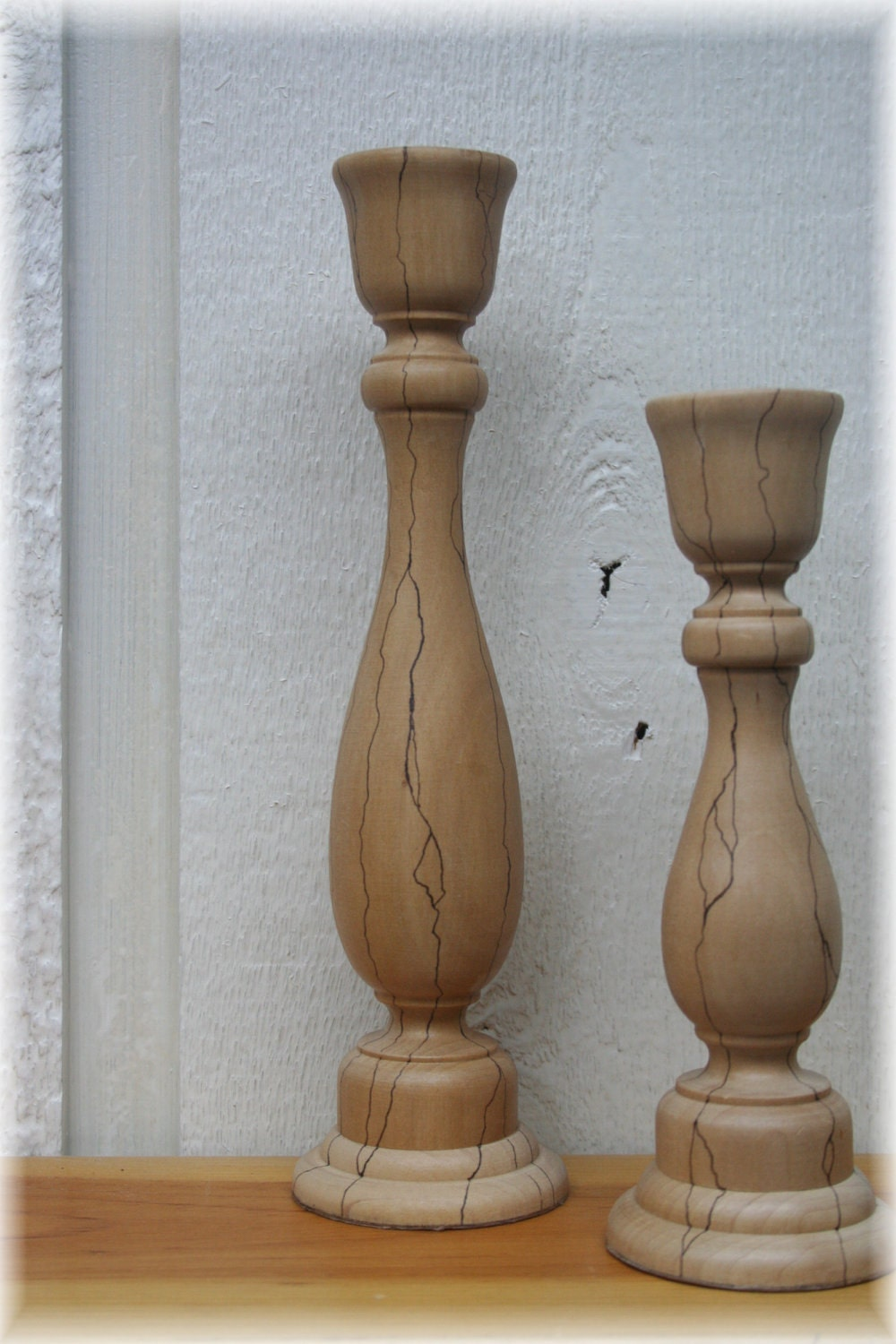 Pair of rustic turned wood candle holders with accentuated Wood candle holders
