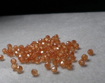 Orange Peachy Microfaceted CZ (Cubic Zirconia )  Round Ball Beads 2mm